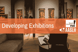 "The inside of a museum is shown underneath an orange banner that reads ""Developing Exhibitions"""