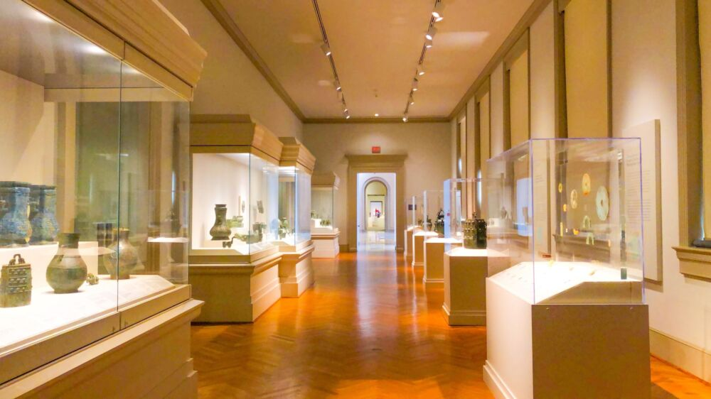A gallery with artifacts in glass cases.