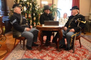 Volunteers in Civil War dress spend time in the Dearborn Historical Museum's Commandant's Quarters.