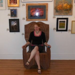 Woman sitting in artistic throne in art gallery