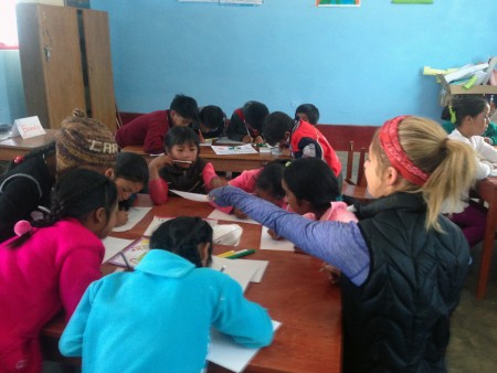 PIARA Team member Carrie Havrilla leading classes on the scientific method with village students.