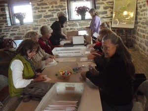 Volunteers at Belle Grove pitch in to prepare the invitations for an annual fundraiser