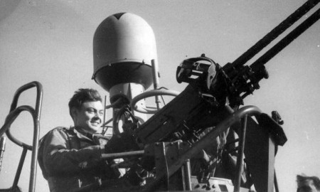 Radarman Third Class Joseph Noeth pictured at the starboard .50-caliber machine gun in winter 1944-45. Via National WWII Museum,