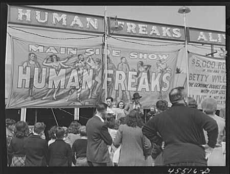 Photograph by Jack Delano. From the Library of Congress Prints Photographs Division Washington, DC. Outside a freakshow at the Rutland Fair in Vermont.